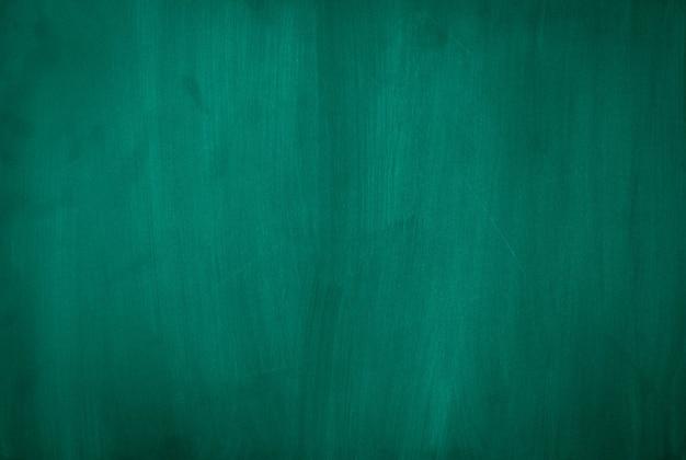 Texture de tableau vert pour ajouter du texte ou une conception graphique. concept d'éducation.