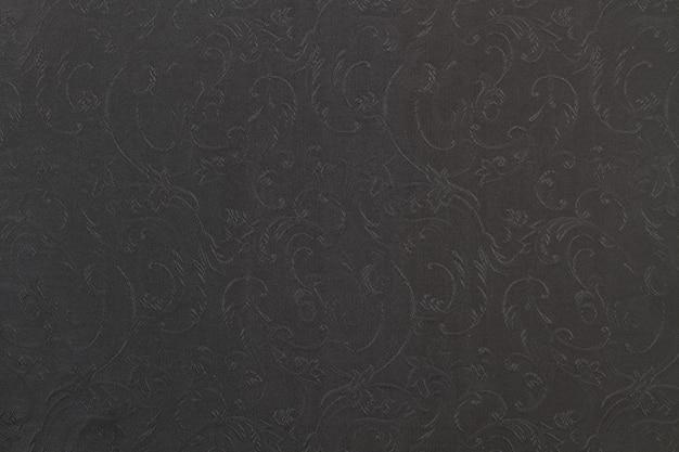 Une texture textile de brocart noir et gris