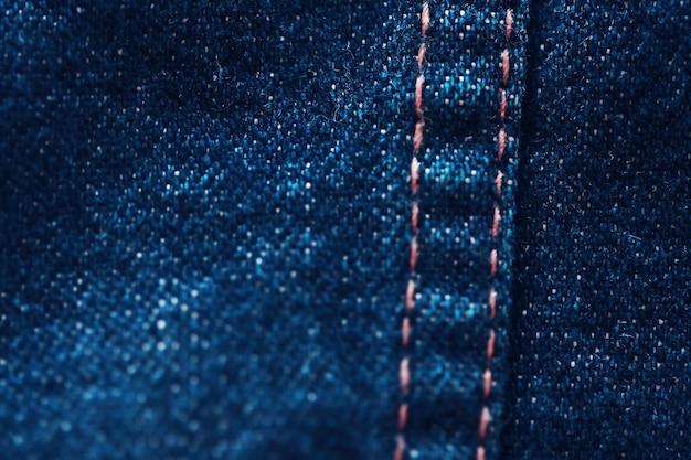 Texture textile en tissu bleu se bouchent, concentrez-vous sur un seul point, arrière-plan flou doux