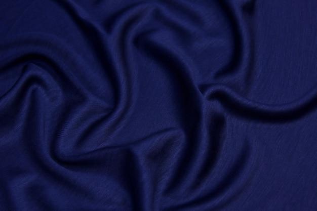 Texture de tissu abstrait de fond bleu jeans, denim ou coton.