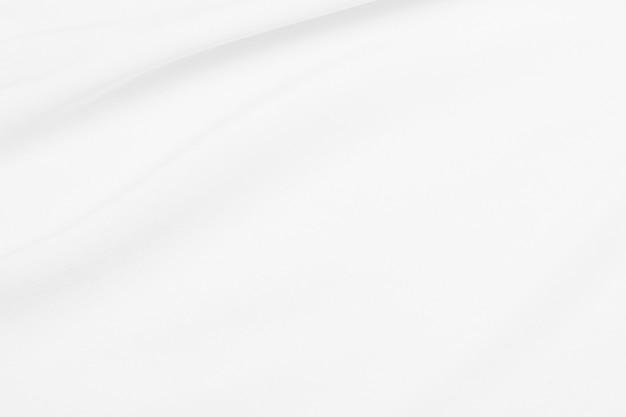 Texture de tissu blanc avec des vagues douces.