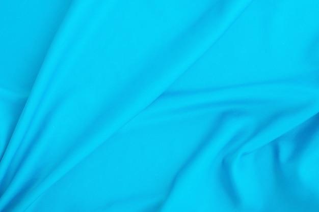 Texture de tissu bleu abstrait.
