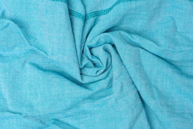 Texture de tissu de coton bleu, tissu torsadé, plein cadre