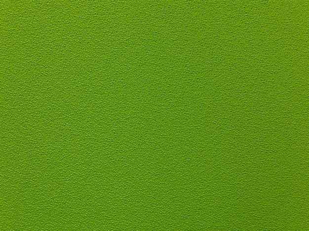 Texture de tissu dense vert foncé. fond de textile vert.