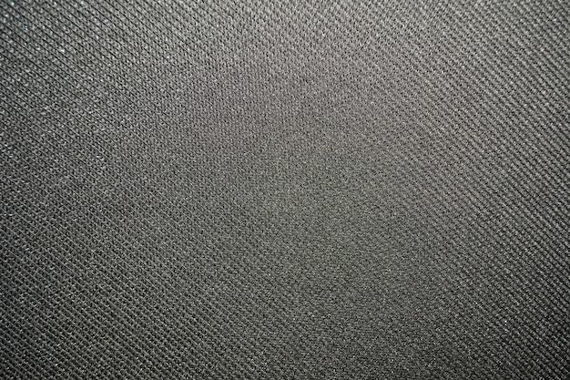 Texture d'un tissu gris uniformément éclairé
