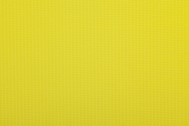 Texture de tissu jaune, fond de tissu
