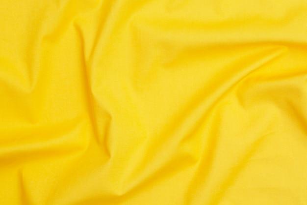 Texture de tissu jaune. jaune. palette de tendance de couleur. vue de dessus, pose à plat.