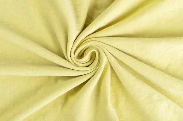 Texture de tissu de lin froissé. textile froissé. jaune.