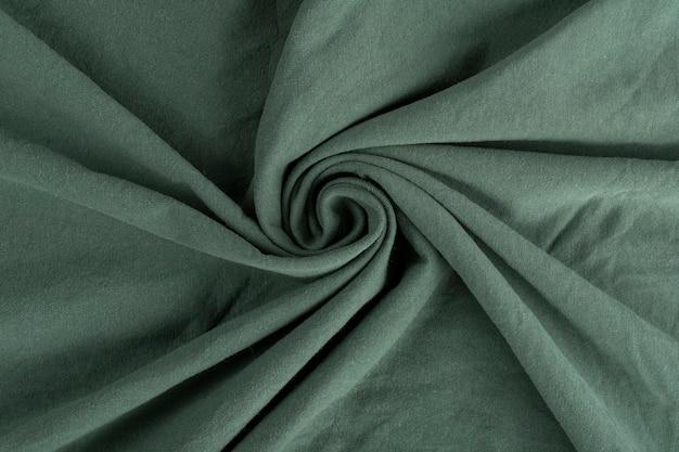 Texture de tissu de lin froissé. textile froissé. vert.