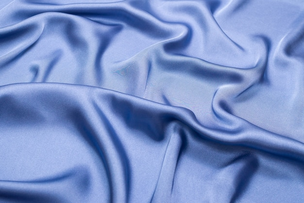 Texture de tissu de luxe en soie bleue ou en satin. vue de dessus.