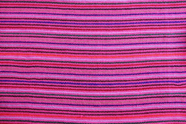 Texture de tissu macro rose vibrant serape mexicaine