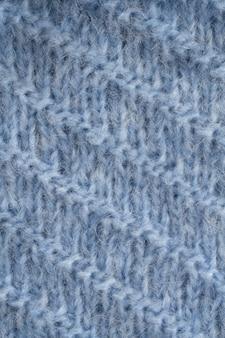 Texture de tissu moelleux tricoté bleu. tricot à la main. fond de fil chaud détaillé.