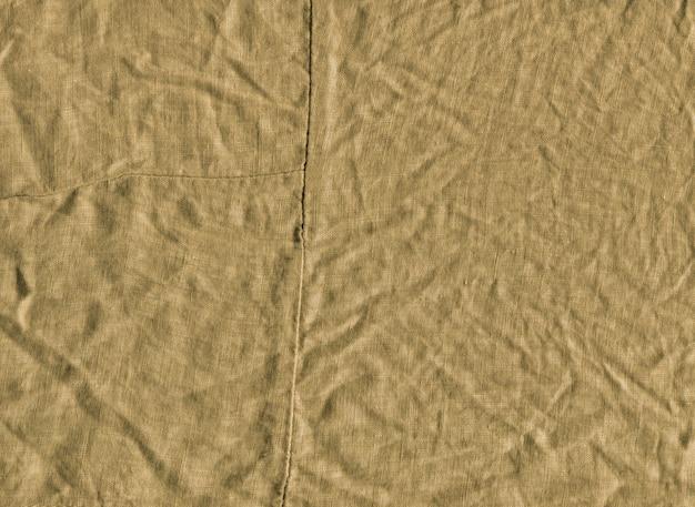 Texture de tissu moutarde pour le fond.