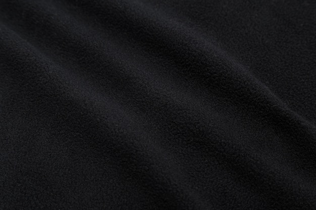 Texture de tissu noir, fond de tissu.