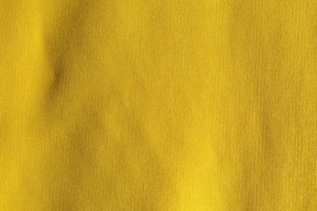 Texture de tissu polyester tissu jaune et fond textile.