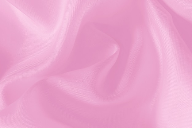 Texture de tissu rose pour le fond et la conception, beau motif de soie ou de lin.