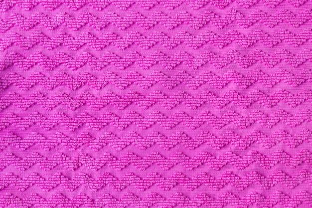 Texture de tissu rose vif avec motif en zigzag.