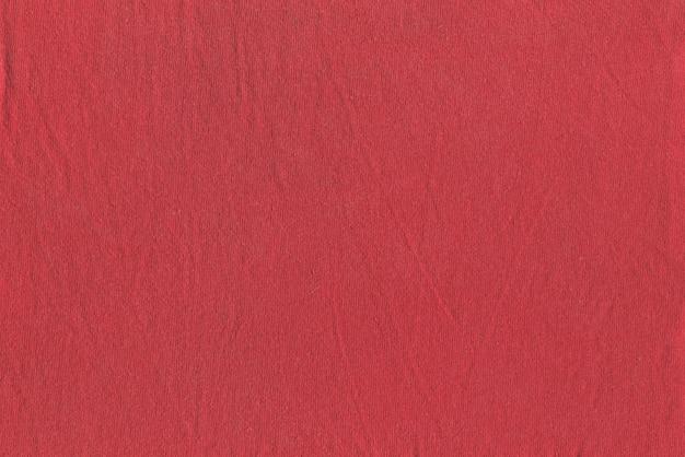 Texture de tissu rouge légèrement froissé