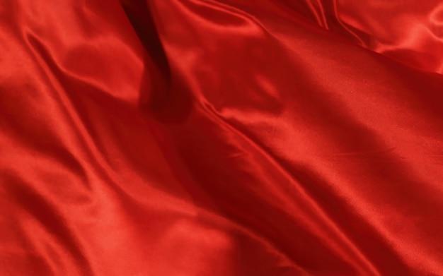 Texture de tissu de soie ou de satin rouge abstrait