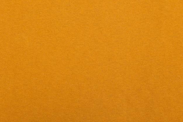 Texture de tissu en tissu jaune.