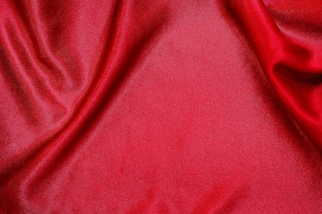 Texture de tissu en tissu rouge pour le fond