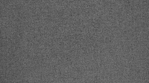 Texture de tissu de tissu synthétique noir - fond gros plan
