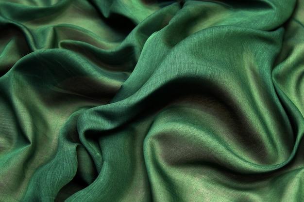 Texture de tissu tricot vert, motif