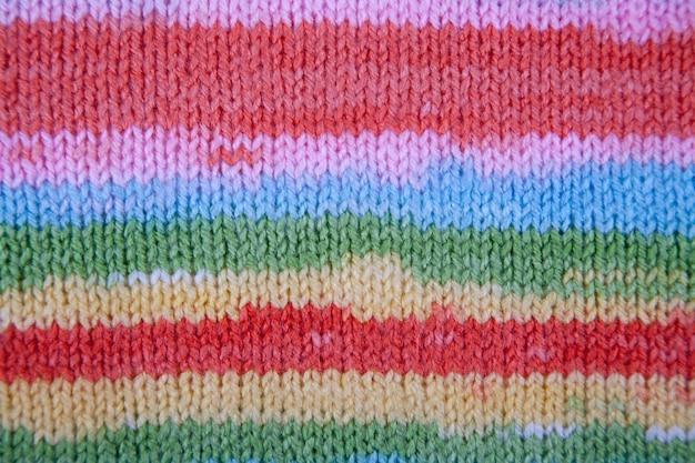 Texture de tissu tricoté à rayures. résumé gros plan de fond de ligne