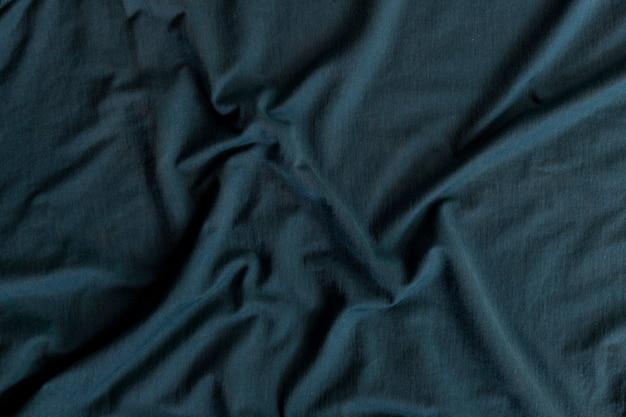 Texture de tissu verdâtre ondulé. abstrait