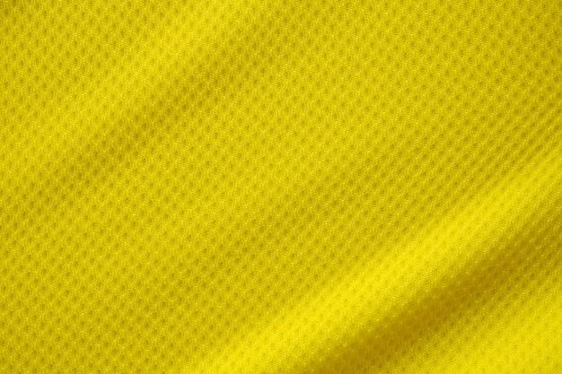 Texture de tissu de vêtements de maillot de football de couleur jaune