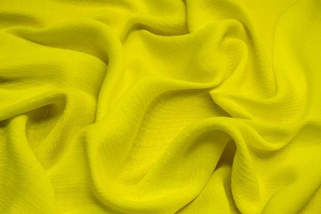 Texture de tissu viscose jaune vif. contexte