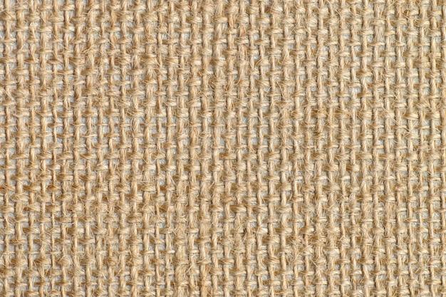 Texture de toile de sac marron avec grille délicate à utiliser comme fond grunge