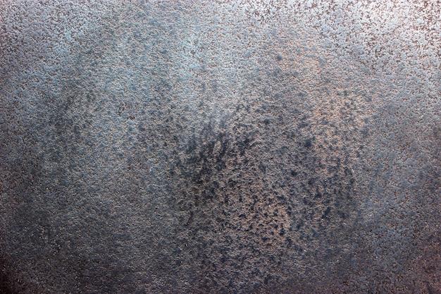 Texture de tôle d'acier noir, fond sombre de métal usé