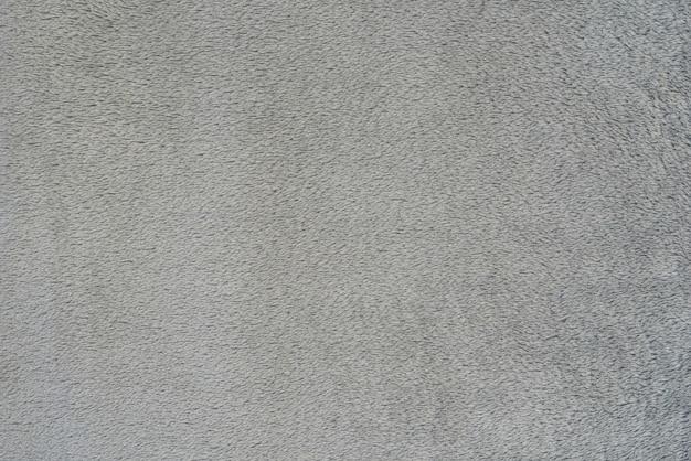 Texture transparente lisse d'une serviette éponge. couleur grise