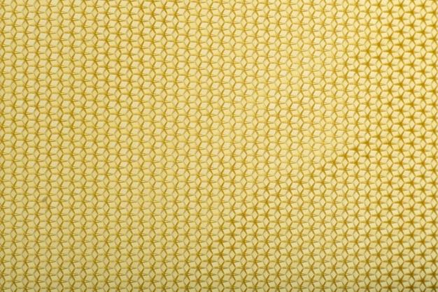 Texture transparente en nid d'abeille jaune. abstrait géométrique. modèle.