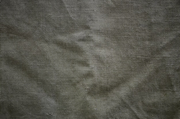La texture d'un très vieux tissu de sac brun. texture rétro avec toile.
