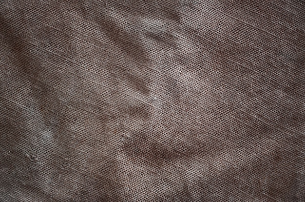 La texture d'un très vieux tissu de sac brun.