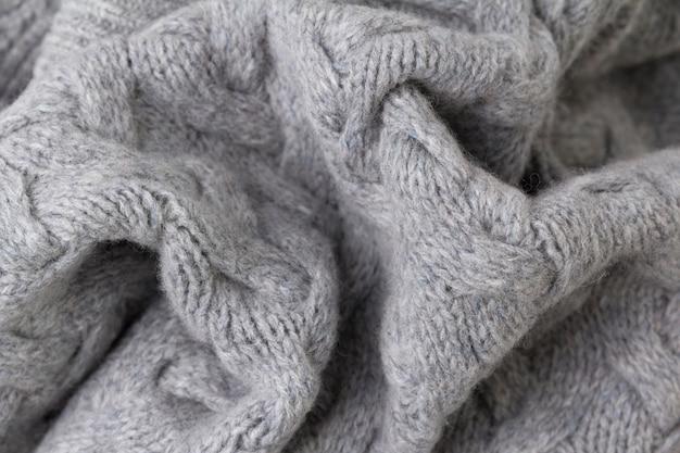 Texture de tricot gris se bouchent. tricot de laine.
