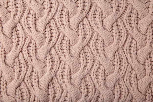 Texture tricotée beige ou arrière-plan. vue de dessus