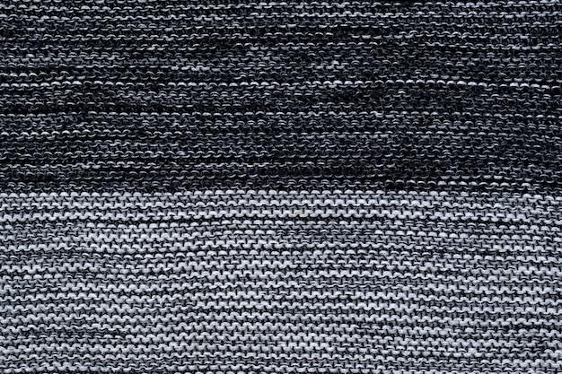 Texture tricotée en noir et blanc. abstrait de tricots. jersey gris.