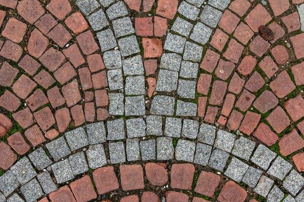 Texture de tuile pavée ancienne dans la vieille ville