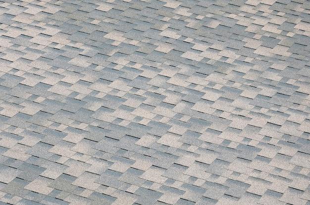 Texture de tuiles plates avec revêtement bitumineux