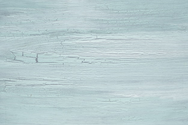 Texture turquoise clair avec de la peinture vieillie vieillie, surface peinte avec des crucks