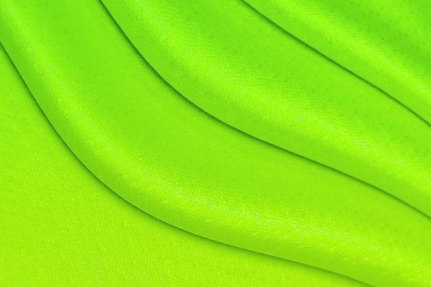 Texture de vagues de tissu de soie verte