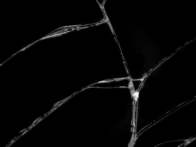 Texture de verre fissuré sur fond noir