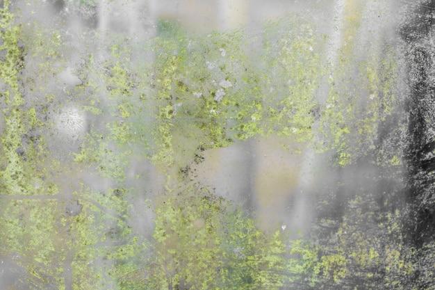 Texture de verre vert grunge noir et mousse