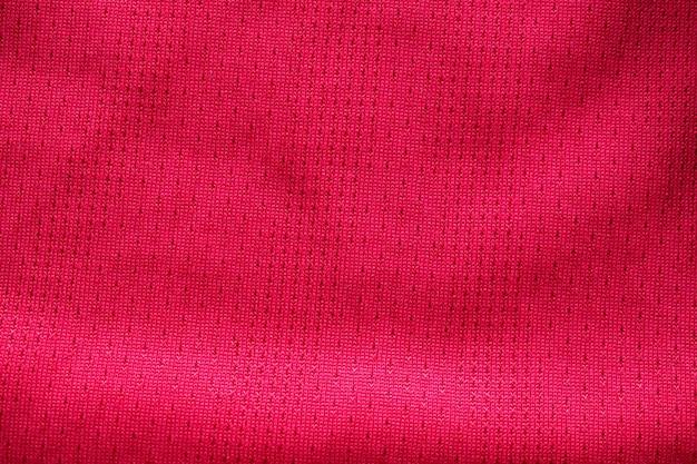 Texture de vêtements de sport en tissu rouge