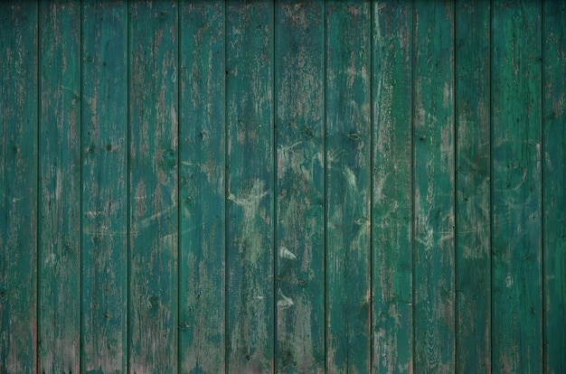 La texture d'une vieille clôture en bois rustique faite de planches traitées à plat
