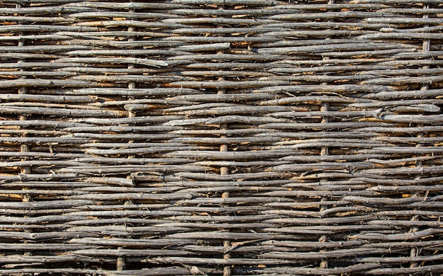 La texture de la vieille clôture en osier bouchent la mise au point sélective