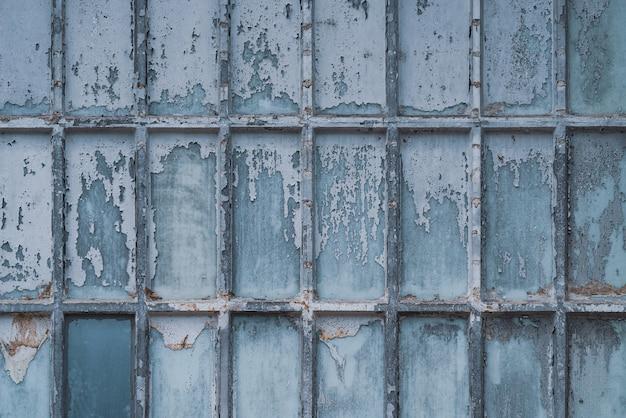 Texture d'une vieille fenêtre en treillis
